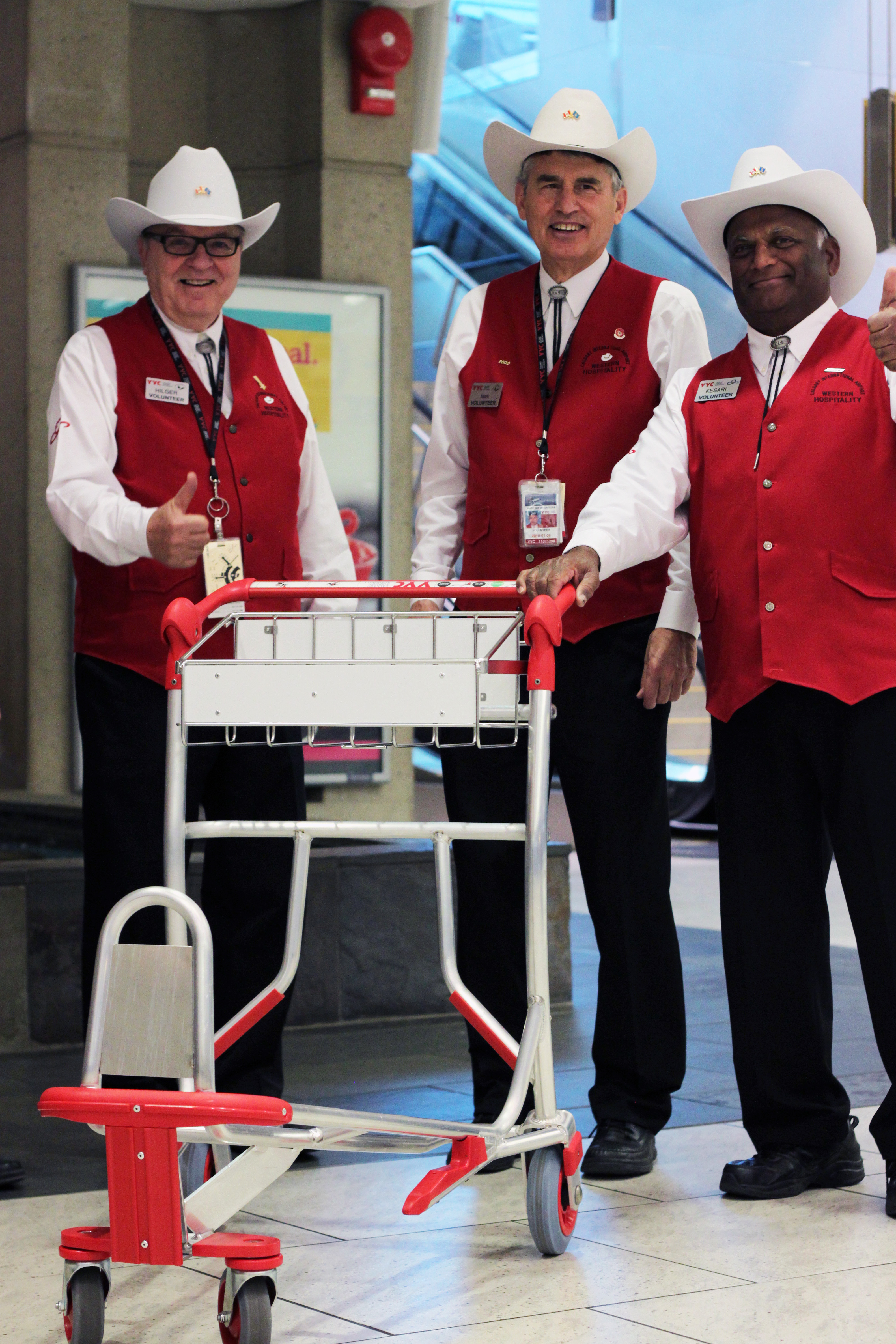 Photo of White Hat Volunteers with new luggage carts at YYC
