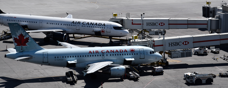 Photo of Air Canada planes on tarmac at YYC